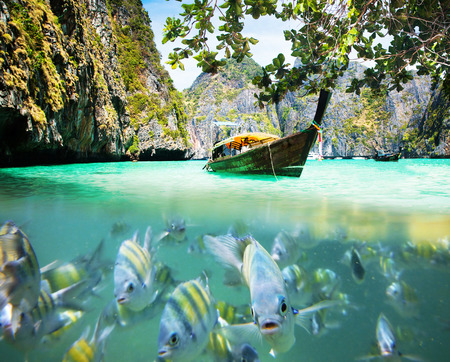 phi phi island: Thailand ocean landscape. Exotic beach view and traditional ship in Maya Bay, Ko Phi Phi Don