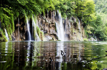 Summer view of beautiful small waterfalls in Plitvice Lakes National Park, Croatia  photo