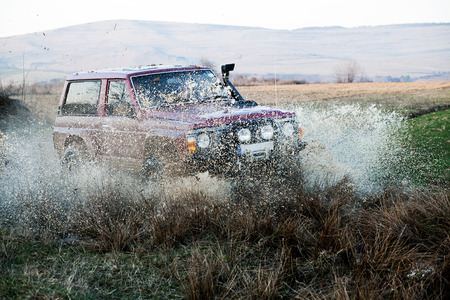 4x4: Off road car in mud Stock Photo
