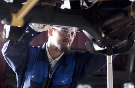 car in garage: Car mechanic at work Stock Photo