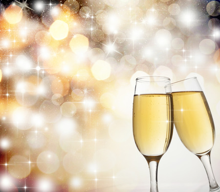 Glasses with champagne against holiday lights photo