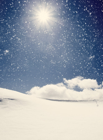 Background of cold winter landscape with snow, blue sky and sunlight photo