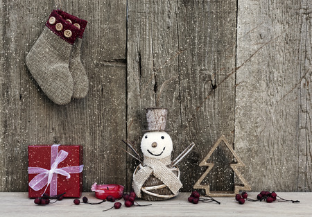 Christmas decorations on rustic wooden background photo