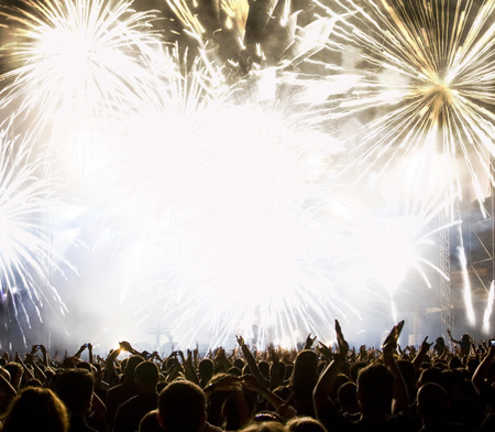 crowd cheering: New Year concept - cheering crowd and fireworks