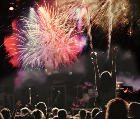 cheering crowd: New Year concept - cheering crowd and fireworks
