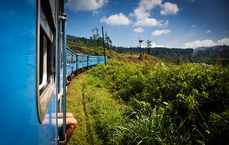 lanka: train from Nuwara Eliya to Kandy among tea plantations in the highlands of Sri Lanka Stock Photo