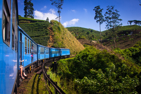 sri: train from Nuwara Eliya to Kandy among tea plantations in the highlands of Sri Lanka Stock Photo
