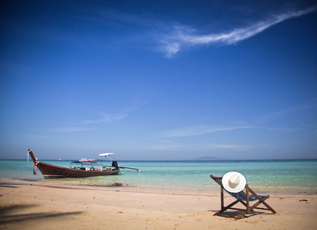 longtail: Exotic beach holiday background with beach chair and long tail boat - Thailand ocean landscape