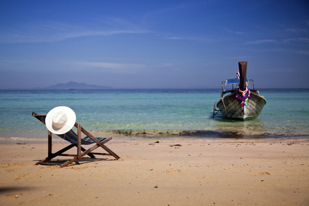 phi phi island: Exotic beach holiday background with beach chair and long tail boat - Thailand ocean landscape