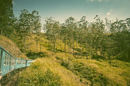 train from Nuwara Eliya to Kandy among tea plantations in the highlands of Sri Lanka photo