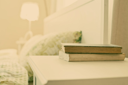 bedside: bedroom with books on nightstand