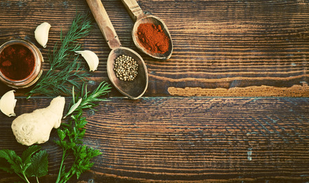 variability: Spices and herbs on wooden table. Top view
