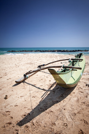 untouched: Untouched tropical beach with fishing boat in Sri Lanka