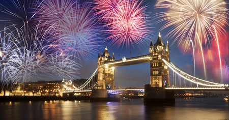 in years: Tower bridge with firework, celebration of the New Year in London, UK Stock Photo