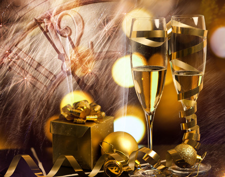 champagne glasses: Toasting with champagne glasses against holiday lights Stock Photo