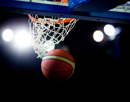 low angles: Basketball going through the hoop at a sports arena