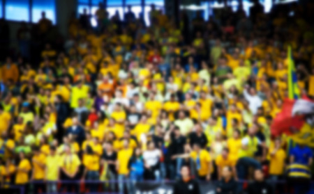 hundreds and thousands: Blurred background of crowd of people in a basketball court