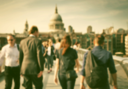 millennium: Blurred background of crowd of people on millennium bridge and st pauls cathedral in background, london