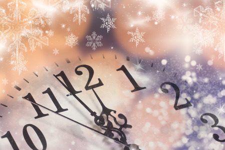 past midnight: old clock with fireworks and holiday lights - New Years at midnight Stock Photo