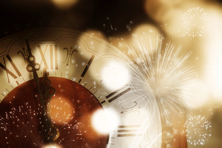 old clock with fireworks and holiday lights - New Years at midnight Stock Photo