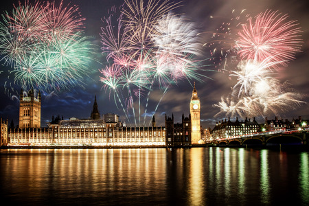 Explosive fireworks display fills the sky around Big Ben. New Years Eve celebration background