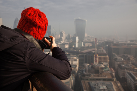 st pauls: woman tourist on top of St Pauls cathedral, London, UK