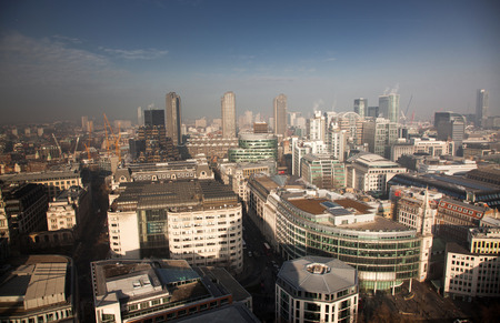 st pauls: rooftop view over London on a foggy day from St Pauls cathedral, UK Stock Photo