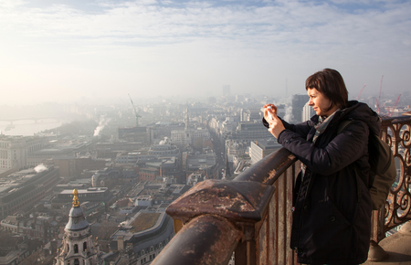 woman tourist on top of St Paul's cathedral, London, UK photo