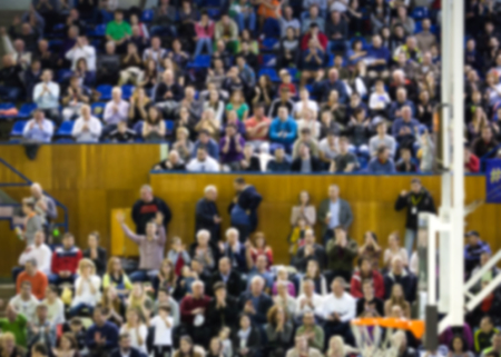 hundreds and thousands: blurred background of crowd of people in a basketball court Stock Photo