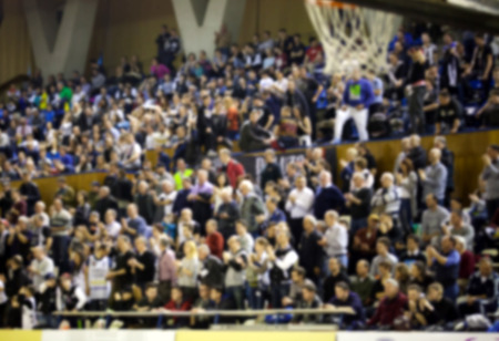 thousands: blurred background of crowd of people in a basketball court Stock Photo