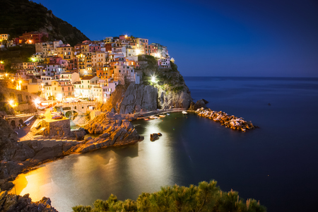 travel amazing Italy series - scenic night view of colorful village Manarola, Cinque Terre