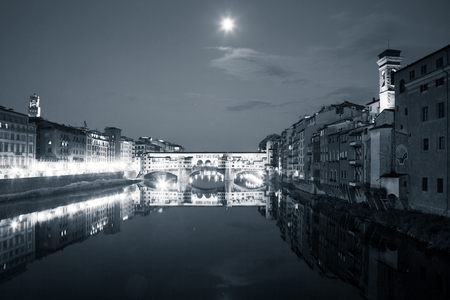 travel amazing Italy series - Ponte Vecchio and River Arno at Night, Florence, Tuscany Stock Photo