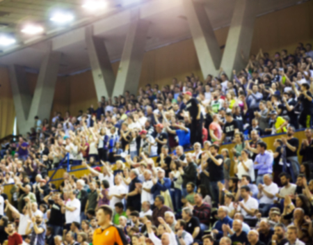blurred background of crowd of people in a basketball court Фото со стока