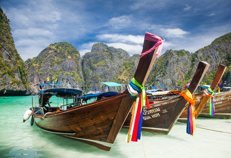 le: KO PHI PHI, THAILAND, February 1, 2014: Traditional long tail boats on the beach of Maya Bay, Ko Phi Phi Leh, Andaman Sea, famous tourist destination in the Ko Phi Phi achipelago