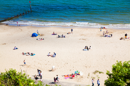 british seaside - summer holiday destination - top view of people on the beach in Bournemouth, Dorset, UK Editorial