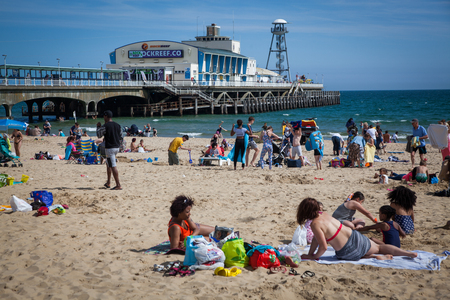 BOURNEMOUTH, UK - 31st MAY, 2017: Unidentified people on Bournemouth Beach and Pier, Dorset, England