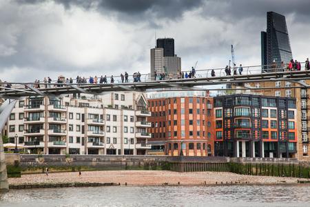 LONDONUK - MAY 20 : Pedestrians crossing Millenium Bridge, London. View from the river