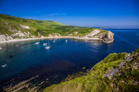 british seaside - summer holiday destination - Lulworth cove on Jurassic coast in southern Devon, UK