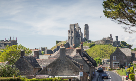 CORFE CASTLE, UK - 1st JUNE, 2017: Village of Corfe and ruins of Corfe Castle, in Swanage, Dorset, Southern England Editorial