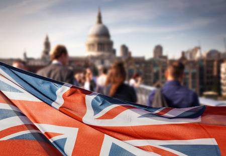 union jack flag and people walking on Millennium bridge at St Paul's cathedral - general elections, London, UK Stockfoto