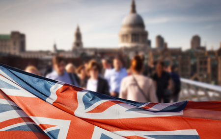 union jack flag and people walking on Millennium bridge at St Paul's cathedral - general elections, London, UK 免版税图像 - 80167498