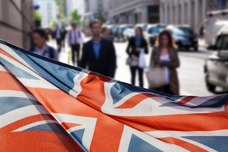 union jack flag and people walking on Millennium bridge at St Pauls cathedral - general elections, London, UK