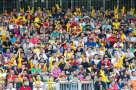 hundreds and thousands: blurred crowd of people in a stadium