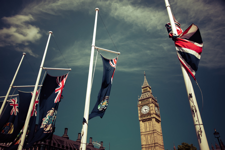 england flags in the wind in front of Big Ben, London, UK