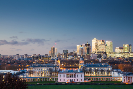 greenwich: London, UK - JANUARY 7, 2016: Panoramic view from Greenwich on Canary Wharf financial district with skyscrapers at night. View includes the park, National Maritime Museum, Royal chapel and O2. Editorial
