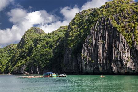 boats among beautiful limestone rocks of Lan Ha bay, the twin of Ha Long bay ona sunny day, Vietnam Stock Photo
