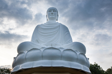 statue of the Buddha against the blue sky. Temple of the Buddha. Vietnam, Nha Trang, Pagoda. Stock Photo