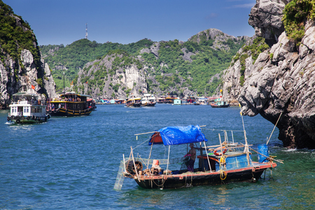 secluded: boats among beautiful limestone rocks of Lan Ha bay, the twin of Ha Long bay ona sunny day, Vietnam Stock Photo