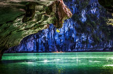 kayaking among caves and lagoon in Ha Long bay, Vietnam. Stock Photo - 85322557