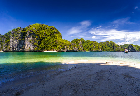 beautiful secluded beaches among limestone rocks on a sunny day in Lan Ha bay, the miniature Ha Long bay, Vietnam